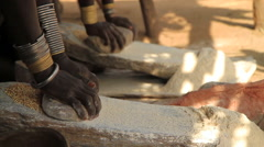 Members of an Omo Valley Tribe Using Traditional Methods to Grind Flour Stock Footage