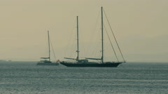 4k Sailing yachts in the sea in the evening Stock Footage