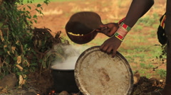 Tribe Members From The Omo Valley Preparing and Handing Out Food Stock Footage