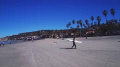 Female Surfer Carrying Surfboard On La Jolla California Beach Stock Footage