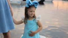 Portrait of a little girl three years with the blue bow on her head Stock Footage