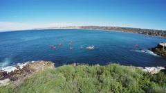 Kayakers Exploring La Jolla Pacific Ocean Marine Park- La Jolla CA Stock Footage