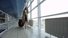 Young and beautiful woman is walking airport hall Stock Footage