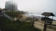 Foggy Pacific Ocean Coastline With High Rise Hotel- La Jolla CA Stock Footage