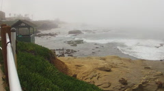 Ocean Waves Crashing On Shore- Foggy Day- La Jolla CA Stock Footage