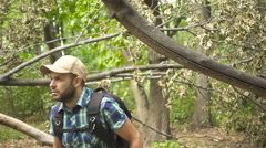 Lost Young Man Looking For Direction In The Forest. Slow Motion. Stock Footage