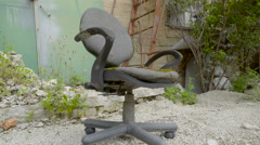 An old swivel chair with a broken seat Stock Footage