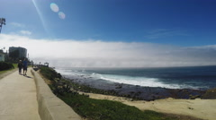 Pan Beach To Pacific Ocean With Fog Bank In Distance- La Jolla CA Stock Footage