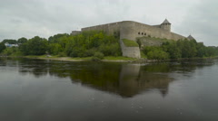 The big castle of Ivangorod and the river Stock Footage