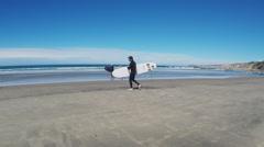 Surfer Walks With Board To Ocean- La Jolla California Beach Stock Footage
