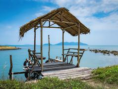 Old wooden bower on the shore of a tropical beach Stock Photos