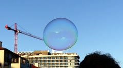 The Hand Breaks the Bubble in Slow Motion. Stock Footage