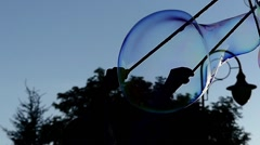 Amazing and Large Soap Bubbles Fly in the Sky. Slow Motion. Stock Footage