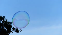 A Huge Soap Bubble Floating in the Sky. Slow Motion. Stock Footage