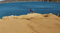 Young Couple Standing On Bluff Overlooking La Jolla Marine Park Stock Footage