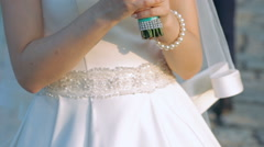 Bride smelling her bouquet in slow motion Stock Footage