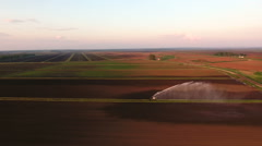 Aerial view:Irrigation system watering a farm field Stock Footage