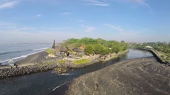 Temple by the sea Pura Campuhan, Jalan Padang Galak, Bali, aerial shot Stock Footage