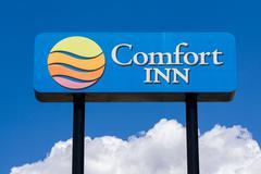 Comfort Inn Sign and Logo Stock Photos