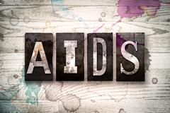 AIDS Concept Metal Letterpress Type Stock Illustration