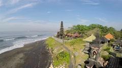 Temple by the sea Pura Campuhan, Jalan Padang Galak, Bali, aerial shot going up Stock Footage