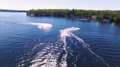 Aerial shot of jet skis speeding on a Michigan Lake Stock Footage