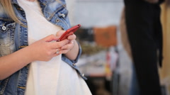 Close-up view of woman typing on cell phone Stock Footage