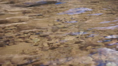 Beautiful lake, clear water and rocks Stock Footage