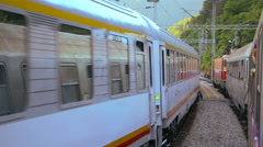 Passenger trains passing each other on the rails in the rural enviroment Stock Footage