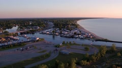 Sunrise aerial shot of a marina at the river mouth Stock Footage