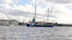 Sailing boat on Neva River against Winter Palace and Saint Isaac's Cathedral Stock Footage