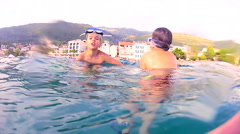 Young boys swimming in the sea, underwater shoot Stock Footage