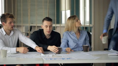 Co-working people are offering agreement to boss Stock Footage