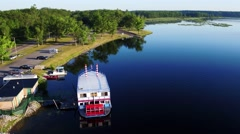 Aerial View of Paddle Boat docked on the Lake Stock Footage