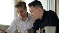 Co-working men are discussing business project in office Stock Footage