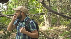Young, Lost Man With talking on the phone Looking For Direction On The Forest Stock Footage