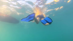 Young boy swim in the sea with fins, underwater shoot Stock Footage