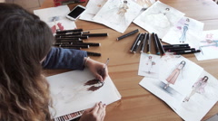 Female fashion designers drawing sketches for clothes in atelier. Stock Footage