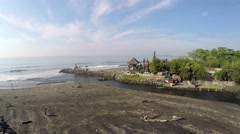 Temple by the sea Pura Campuhan, Jalan Padang Galak, Bali, aerial shot Stock Footage