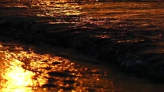 Waves of the Sea at Sunset in Slow Motion. Golden Time. Stock Footage