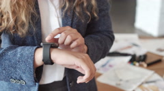 Woman making gestures on a wearable smartwatch computer device, smart watch. Stock Footage