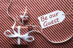 Two Gifts With Label, Text Be Our Guest Stock Photos