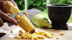 Slow motion of preparing corn for cooking Stock Footage