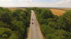 Aerial view of cars moving on two lane road in forest. 4K Stock Footage