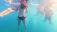 People swim in the sea, underwater shoot Stock Footage
