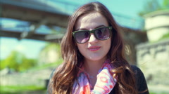Pretty girl taking off sunglasses and smiling to the camera Stock Footage