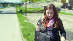 Girl packing something to her bag and going somewhere Stock Footage