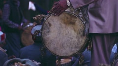Close up of Hindu man playing traditional drum Stock Footage