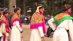 Line of Hindu men dance in a festival, panning with musicians in background Stock Footage