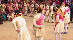 Line of Hindu men in white and red clothing dance in line during a festival. Stock Footage